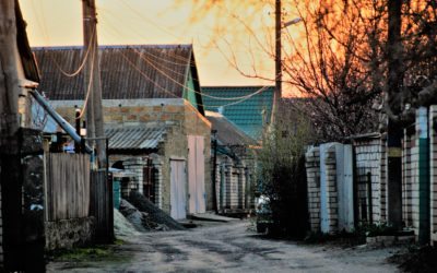 dirt road in Romani Village in Ukraine during sunset
