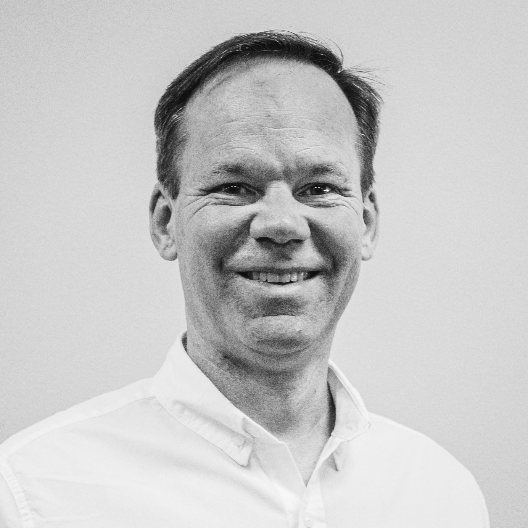 portrait of white middle aged man, edited in black and white